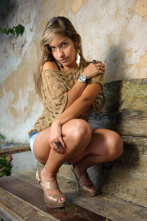 Beautiful and shy model lowered on a bench photo