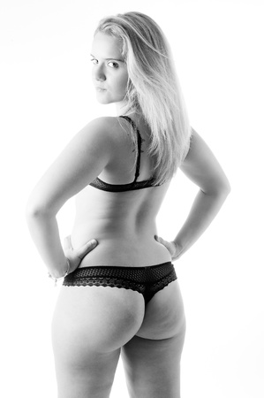Beatuful young woman in lingerie high key sexy studio portrait in black and white Stock Photo - 10751872
