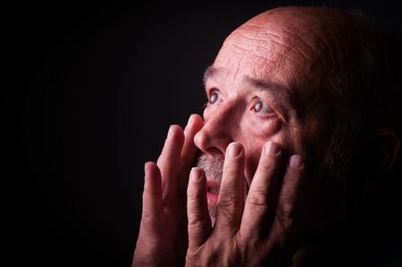 discourage: old man looking frighten or scared