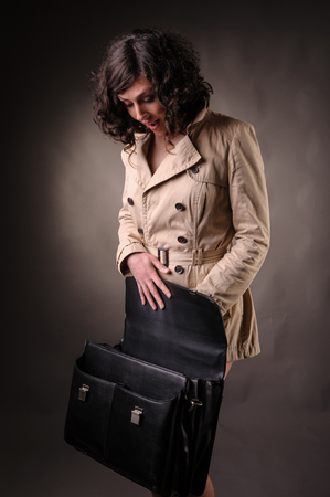 blown away: business woman opening a suitcase