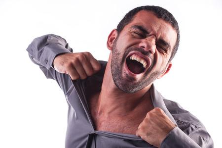 ripping shirt: man screaming and ripping his shirt