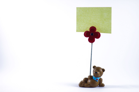 postit: Teddy bear with a blank sign in a white background Stock Photo