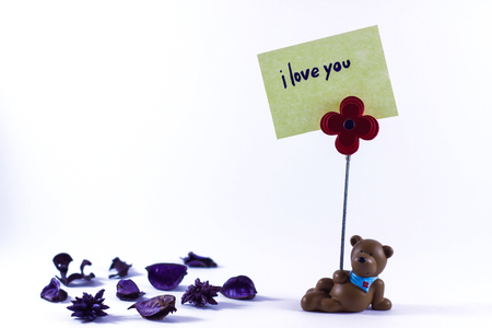 postit: Teddy bear with a I Love You sign in a white background Stock Photo