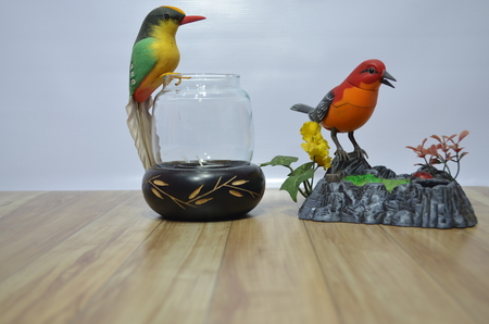 adorning: Beautiful bird sculptures adorning the various locations.
