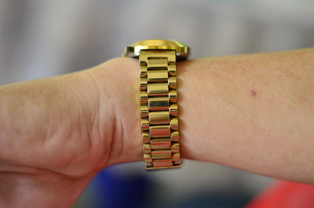 expensive: Luxury expensive gold watch on your wrist.
