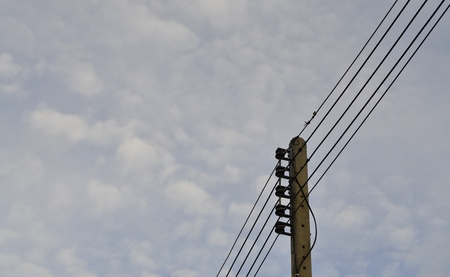polarity: Low voltage line supplying electricity to residential. Stock Photo
