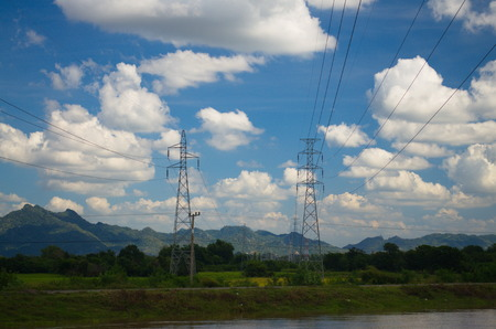 Pole and high voltage transmission lines outdoors.