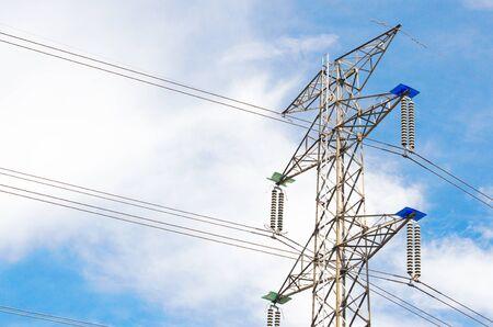 High voltage transmission line and pole on sky background. Stok Fotoğraf