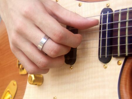 Pentatonic scale. Right hand with electric guitar. Stock Photo