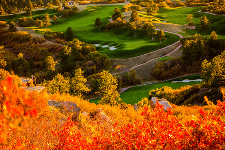 denver parks: Looking down to the valley of Colorado while the evening sun reflecting upon the green grass and the spectacular autumnal  color. Colorado lash fall leaves lift  ,nourished and relaxed your inner soul.Colorado is a great place to visit during fall season.