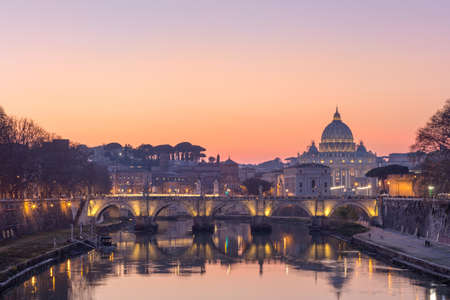 Sunset over the Vatican City in Rome, St. Peter Basilica, St. Angelo Bridge and Tevere River in Rome, Italy