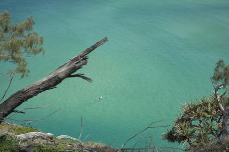Beautiful Stradbroke Island with a swimmer Stock Photo
