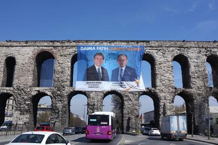 fatih: Istanbul Metropolitan Municipality Mayor Kadir Topba  351; and Fatih Mayor Mustafa Demir s photos are observed at the huge banner on Valens Aqueduct, Fatih, Istanbul