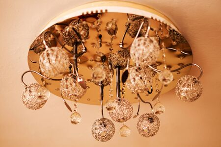 Crystal chandelier hanging on the ceiling.