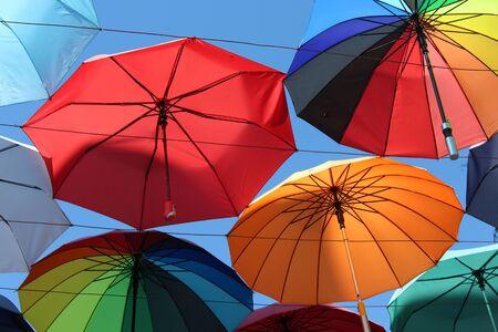 joyous festivals: Under a rainbow of umbrellas. Soaring in the sky multi-colored umbrellas.