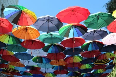 joyous festivals: Under a rainbow of umbrellas. Soaring in the sky multi-colored umbrellas.