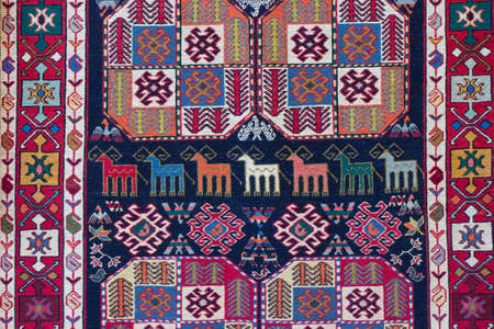 A fragment of national Azerbaijan carpet. Culture of Azerbaijan on the ancient handmade carpet.
