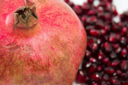 Pomegranate against the grains, low depth of focus photo