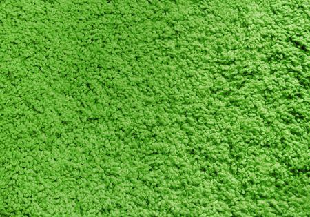 Fluffy green carpet, texture, background.