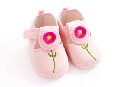 Pink toddlers shoes with flowers photo