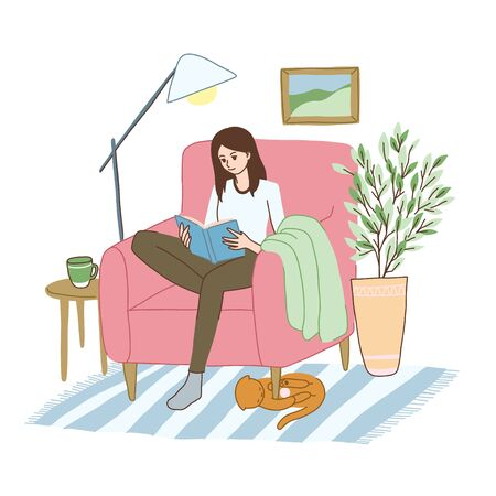 Young woman is relaxing in the armchair with book.