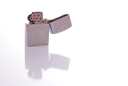 Steel cigarette lighter isolated on white background photo