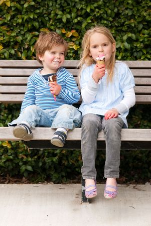 Children sitting in park eating ice-cream Stock Photo - 5721159