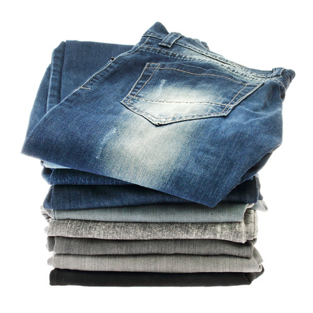bluejeans: Many stacks of jeans isolated on a white background Stock Photo