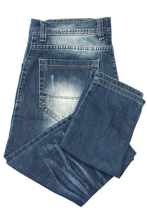 Gevouwen blauwe spijkerbroek geïsoleerd op wit Stockfoto - 39244655