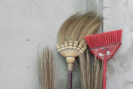 brooms: brooms stick on brick wall Stock Photo