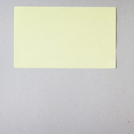Yellow stick note on gray background