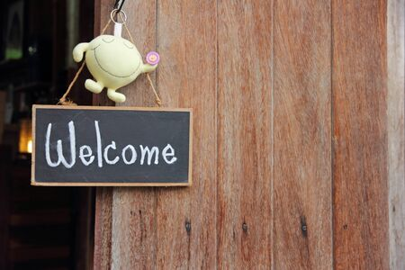 wooden frame WELCOME over old wooden door photo