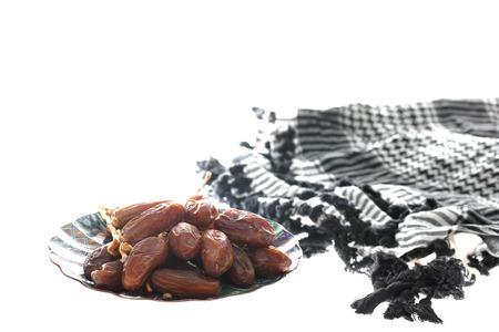 dactylifera: Dried dates (Phoenix dactylifera l) isolated on white background