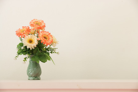 vases: Flower bouquet on headboard.