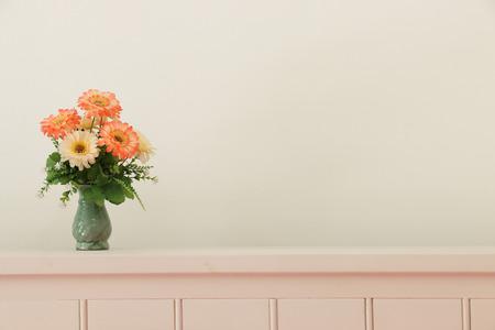 Flower bouquet on headboard.