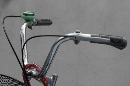 handlebars: Close up bicycle bell on handlebars.