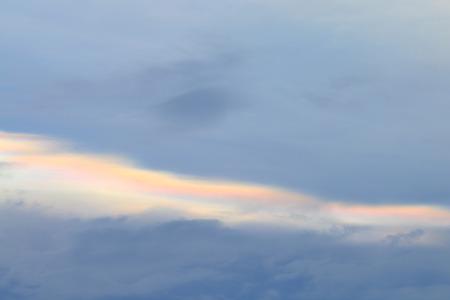 phenomenon: Cloud iridescence phenomenon on sunset sky. Stock Photo