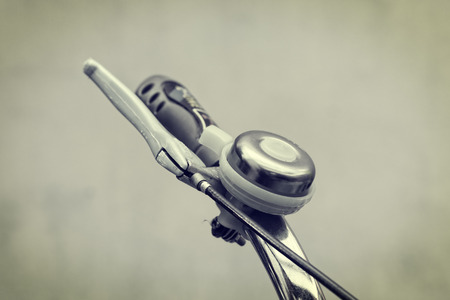 handlebars: Close up bicycle bell on handlebars  - vintage effect style