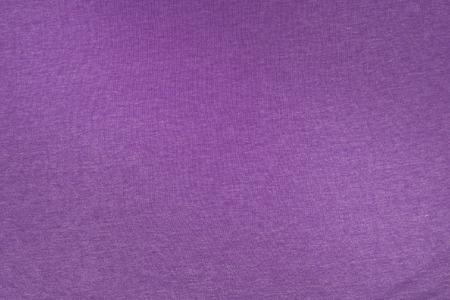 morado: Textura de la tela púrpura. Foto de archivo