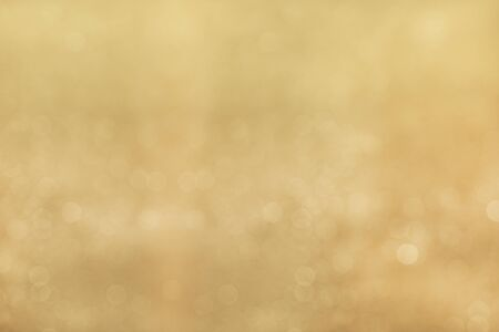 bokeh background: Defocused gold abstract bokeh background. Stock Photo