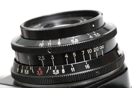 film: Closeup of old film camera lens. Stock Photo