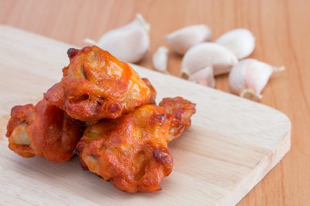 cutting boards: Chicken wings on wooden cutting boards.
