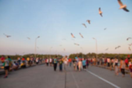 samut prakan: blurred people with seagull at bangpu, samut prakan.