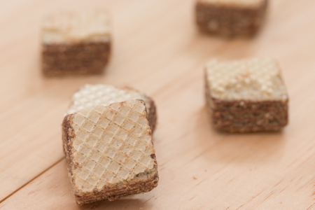 wafers: Wafers with chocolate on wooden background. Stock Photo