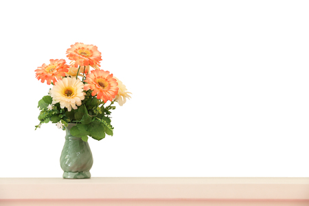 headboard: Flower bouquet on headboard isolated on white background. Stock Photo