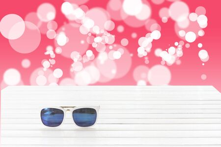 eyewear: sunglasses with abstract bokeh background Stock Photo
