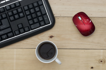 keyboard and mouse: Workplace, keyboard mouse and coffee on wood table.