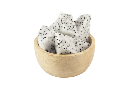 Dragon fruit in wooden bowl isolated on white background - clipping path.