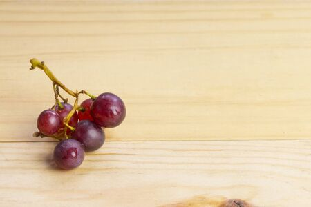 berry: group of fresh red grape on wood table