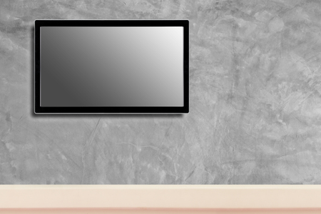 LED television screen mockup, blank hdtv on concrete wall in the room Stock Photo